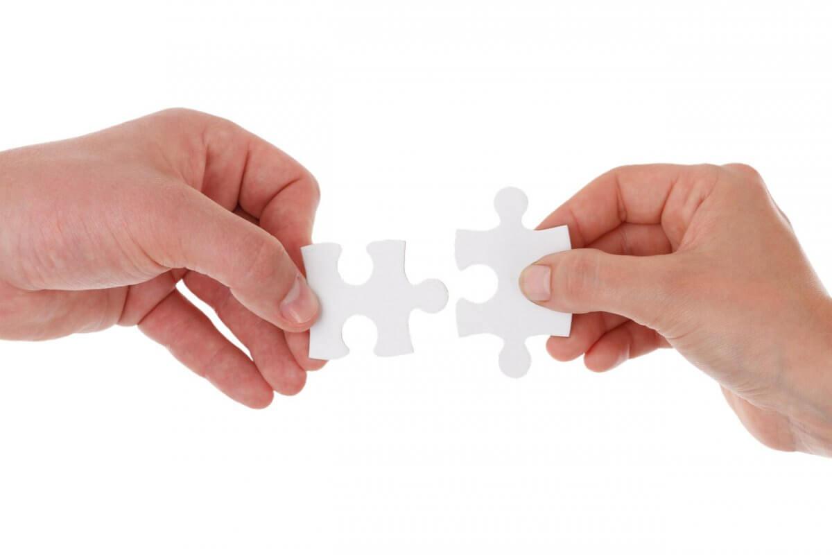 windhoff-group-haende-mit-puzzleteil